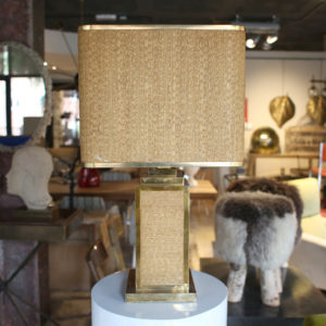 Raffia and brass table lamp